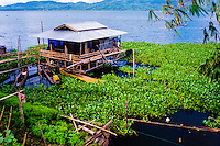 Indonesia, Sulawesi, Tondano. Lake Tondano is a large lake along the side of an ancient volcanic caldera. This house is built on stilts above the water.