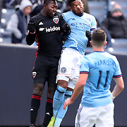 NEW YORK, NEW YORK - March 12:  Patrick Nyarko #12 of D.C. United and Ethan White #3 of New York City FC challenge for the ball during the NYCFC Vs D.C. United regular season MLS game at Yankee Stadium on March 12, 2017 in New York City. (Photo by Tim Clayton/Corbis via Getty Images)