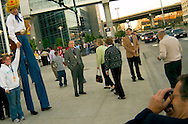 Omaha, Neb 5/6/06 David McCullough of Justin Boots entertains the lines at the Berkshire Hathaway annual meeting outside the Qwest Center Omaha Saturday Morning..(Chris Machian/Prairie Pixel Group)