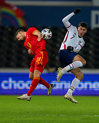 SWANSEA, WALES - Thursday, November 12, 2020: Wales' James Lawrence (L) and USA's Giovanni Reyna during an International Friendly match between Wales and the USA at the Liberty Stadium. (Pic by David Rawcliffe/Propaganda)