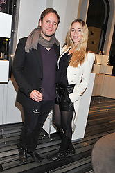 NICHOLAS KIRKWOOD and FLORENCE BRUDENELL-BRUCE at a party to celebrate the launch of a limited edition shoe The Chambord in celebration of Nicholas Kirkwood's partnership with Chambord black raspberry liqueur, held at the Nicholas Kirkwood Boutique, 5 Mount Street, London on 12th December 2012.