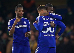 LONDON, ENGLAND - Wednesday, December 10, 2014: Chelsea's substitute Ruben Loftus-Cheek gets a hug from Kurt Zouma after making his debut against Sporting Clube de Portugal during the final UEFA Champions League Group G match at Stamford Bridge. (Pic by David Rawcliffe/Propaganda)