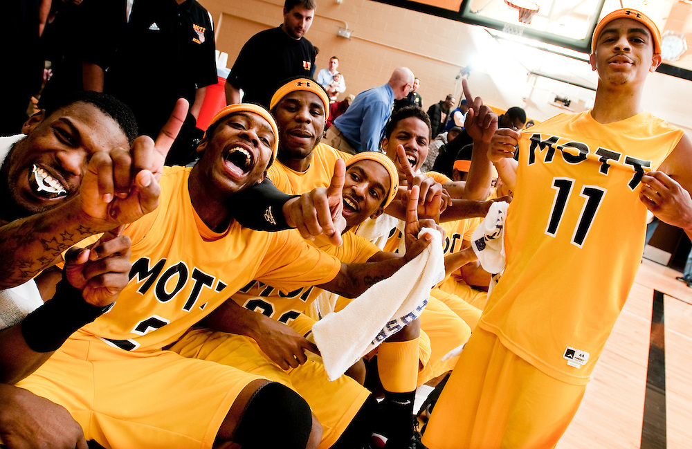 Matt Dixon | The Flint Journal..Mott's mugs for the camera after defeating Delta college to win the district championship, Saturday, March 5.