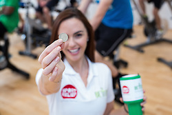 "© Licensed to London News Pictures . 01/03/2016 . Manchester , UK . Hollyoaks actress JENNIFER METCALFE (holding £1 coin) launches a national fundraiser , "" The Better Bike Challenge "" from the East Manchester Leisure Centre in Beswick . The Challenge features 10,000 people cycling one-mile , each donating £1 to #TeamBetter for Sport Relief . Photo credit : Joel Goodman/LNP"