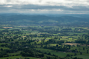 View from Titterstone Clee Hill towards the town of Ludlow on 10th May 2021 in Titterstone Clee Hill, near Ludlow, Shropshire, United Kingdom. Titterstone Clee Hill, sometimes referred to as Titterstone Clee or, incorrectly, Clee Hill, is a prominent hill in the rural English county of Shropshire, rising at the summit to 533 metres above sea level. It is one of the Clee Hills, in the Shropshire Hills Area of Outstanding Natural Beauty.