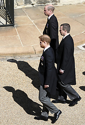 The Duke of Sussex, the Duke of Cambridge and Peter Phillips follow the Duke of Edinburgh's coffin, covered with his Personal Standard, on the purpose built Land Rover Defender during the Ceremonial Procession ahead of the funeral of the Duke of Edinburgh in Windsor Castle, Berkshire. Picture date: Saturday April 17, 2021.