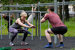 © Licensed to London News Pictures. 28/05/2021. London, UK. A couple exercising in Finsbury Park, north London on a warm day. According to the Met Office, a high of 24 degrees celsius is forecast for the bank holiday weekend, after weeks of rain in the capital. Photo credit: Dinendra Haria/LNP
