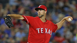 May 25, 2018 - Arlington, TX, USA - Texas Rangers relief pitcher Alex Claudio (58) pitches in the seventh inning as the Kansas City Royals play the Texas Rangers at Globe Life Park in Arlington, Texas, Friday, May 25, 2018. (Credit Image: © Rodger Mallison/TNS via ZUMA Wire)