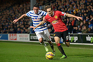 Daley Blind of Manchester United and Mauricio Isla of QPR compete for the ball. Barclays Premier league match, Queens Park Rangers v Manchester Utd at Loftus Road in London on Saturday 17th Jan 2015. pic by John Patrick Fletcher, Andrew Orchard sports photography.