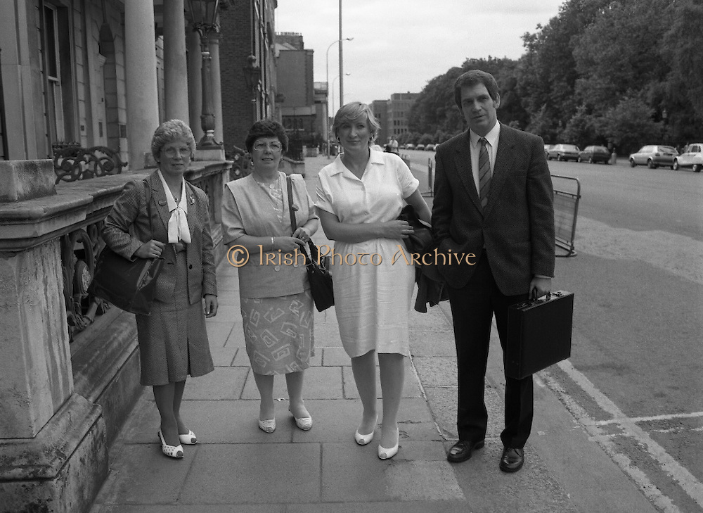 Annie Maguire Visits Tanaiste At Iveagh House. (R61)..1987..07.07.1987..7th July 1987..As part of her campaign to prove the Innocence of the Maguire 7 and The Guildford 4, Annie Maguire took her case to The Tanaiste, Brian Lenihan, at Iveagh House in Dublin. Mrs Maguire's contention was that the 4 and 7 were wrongly convicted using suspect and fraudulent evidence. The 4 and 7 were convicted in England for pub bombings which was said were carried out by the IRA who took their bombing campaign from Northern Ireland to the streets of English cities...Image shows the arrival of the Maguire group at Iveagh House, (L-R) Mary McCaffery, sister of Annie,  Annie Maguire, Therese Smalley and Errol Smalley, Chairman of the Guildford 4 and Maguire Family Relatives Support Group.