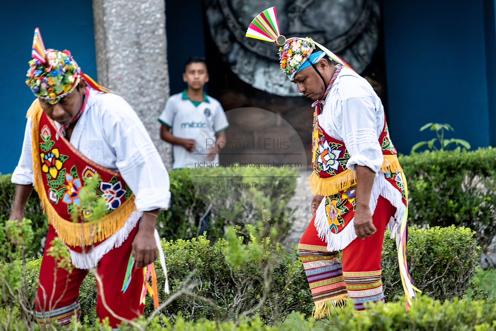 Voladores perform the sacred ritual before climbing a pole for the ceremonial dance in the Parque Takilhsukut at the pre-Columbian archeological complex of El Tajin in Tajin, Veracruz, Mexico. The Danza de los Voladores is a indigenous Totonac ceremony involving five participants who climb a thirty-meter pole. Four of these tie ropes around their waists and wind the other end around the top of the pole in order to descend to the ground. The fifth participant stays at the top of the pole, playing a flute and a small drum. The ceremony has been inscribed as a Masterpiece of the Oral and Intangible Heritage of Humanity by UNESCO.