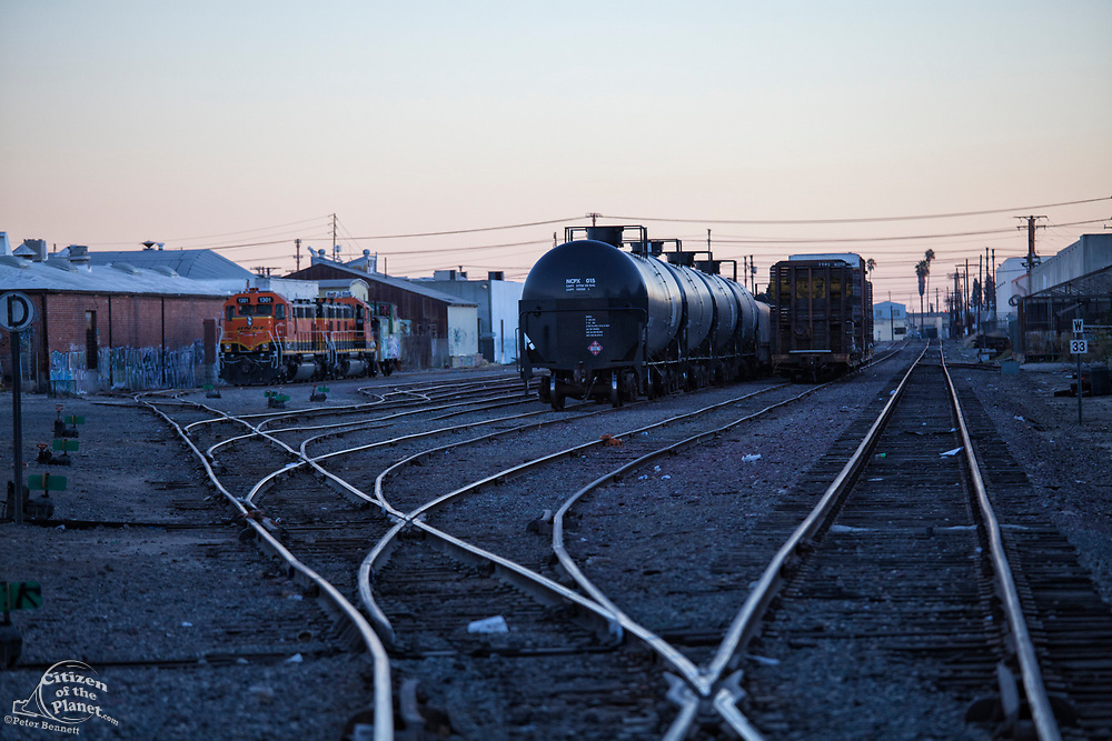 Locomotive engine and train in Vernon, a very industrial city in the shadow of downtown Los Angeles, California, USA