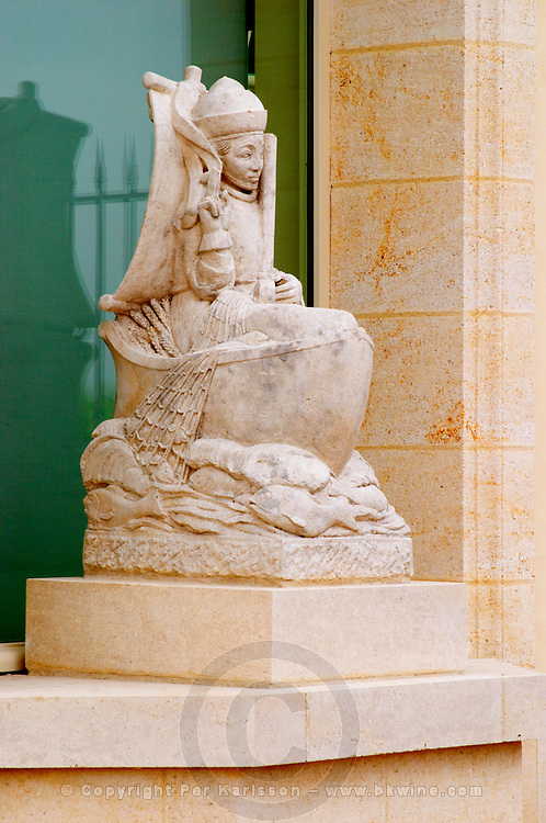 The newly renovated Chateau Petrus with a stone statue of Peter the Apostle in a boat with fishing net and fish in a niche Pomerol Bordeaux Gironde Aquitaine France