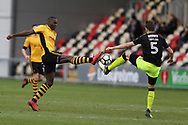 Frank Nouble of Newport County is challenged by Greg Taylor of Cambridge Utd (r).  The Emirates FA Cup, 2nd round match, Newport County v Cambridge United at Rodney Parade in Newport, South Wales on Sunday 3rd December 2017.<br /> pic by Andrew Orchard,  Andrew Orchard sports photography.