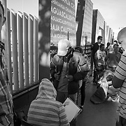 Migrants mostly from Honduras and Guatemala fleeing gang violence and death threats traveled nearly a month before arriving in Tijuana, Mexico where they planned to seek asylum at the San Ysidro Port of Entry. Migrants must get their name on the list managed by another migrant and wait to be called. The wait can take months. Thousands of names were already on the list as thousands of more migrants have arrived in recent days.