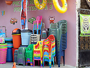 Plastic chairs and bins for sale outside a store. Panajachel, Republic of Guatemala. 04Mar14.