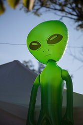 Alien Blow up doll on a wire at a state fair