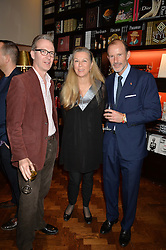 Left to right, ASHLEY HICKS, Marie Christine de Laubarede and PRINCE KYRIL OF BULGARIA at a party to celebrate the launch of the Maison Assouline Flagship Store at 196a Piccadilly, London on 28th October 2014.  During the evening Valentino signed copies of his new book - At The Emperor's Table.