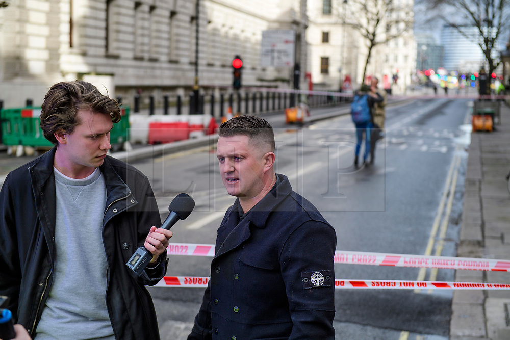 © Licensed to London News Pictures. 22/03/2017. London, UK. Former EDL leader TOMMY ROBINSON scene speaking at the scene of suspected terrorist attack near Houses of Parliament in Westminster, London. Photo credit: Ben Cawthra/LNP