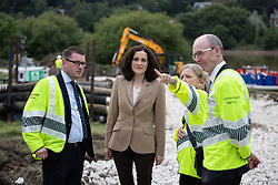 © Licensed to London News Pictures. 03/08/2019. Whaley Bridge, UK. THERESA VILLIERS , Secretary of State for Environment, Food and Rural Affairs , speaks to Environment Agency staff , close to the reservoir . The town of Whaley Bridge in Derbyshire remains evacuated after heavy rain caused damage to a slipway on the Toddbrook Reservoir , threatening homes and businesses with flooding. Photo credit: Joel Goodman/LNP