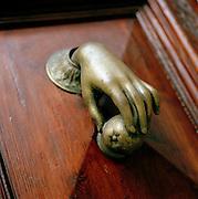 Detail of a brass door knocker in Barcelona, Spain