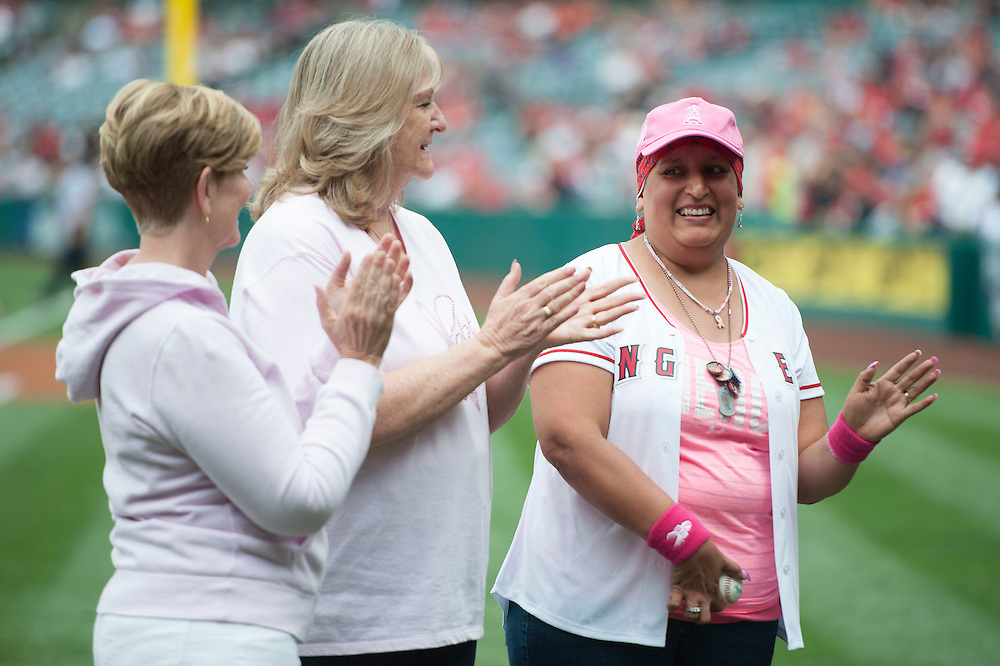 Breast cancer survivor Patty Rayburn waves to the crowd after being introduced before the Angels game Sunday.<br /> <br /> ///ADDITIONAL INFO:   <br /> <br /> angels.0509.kjs  ---  Photo by KEVIN SULLIVAN / Orange County Register  --  5/8/16<br /> <br /> The Los Angeles Angels take on the Tampa Bay Rays at Angel Stadium Sunday.<br /> <br />  5/8/16