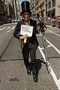 """New York, NY - 25 June 2017. New York City Heritage of Pride March filled Fifth Avenue for hours with groups from the LGBT community and it's supporters. A man dressed as Abraham Lincoln with a sign reading """"Black lives matter."""""""