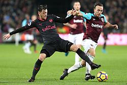 13 December 2017 - Premier League Football - West Ham United v Arsenal - Mesut Ozil of Arsenal and Mark Noble of West Ham battle for the ball - Photo: Charlotte Wilson / Offside