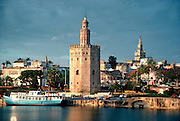 SPAIN, ANDALUSIA, SEVILLE River, Cathedral and Torre del Oro
