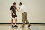 BFA head coach Dave Demar talks to Owen Demar (3) during the boys basketball game between the BFA Fairfax Bullets and the Vergennes Commodores at Vergennes Union High School on Thursday night December 13, 2018 in Vergennes. (BRIAN JENKINS/ for the FREE PRESS)