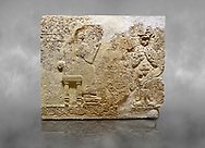 """Hittite relief sculpted orthostat stone panel  of Long Wall Limestone, Karkamıs, (Kargamıs), Carchemish (Karkemish), 900-700 BC. Anatolian Civilisations Museum.<br /> <br />  The hieroglyphics reads; """"I am Win-a-tis, beloved wife of my Lord Suhi, wherever and whenever my husband honours his name, he will honour my name as well with favours"""". Underneath, there are two goddess figures, one is naked with a horned head, holding her breasts with her hands. Her genitalia is indicated by a triangle. <br /> <br /> On a grey art background. .<br />  <br /> If you prefer to buy from our ALAMY STOCK LIBRARY page at https://www.alamy.com/portfolio/paul-williams-funkystock/hittite-art-antiquities.html  - Type  Karkamıs in LOWER SEARCH WITHIN GALLERY box. Refine search by adding background colour, place, museum etc.<br /> <br /> Visit our HITTITE PHOTO COLLECTIONS for more photos to download or buy as wall art prints https://funkystock.photoshelter.com/gallery-collection/The-Hittites-Art-Artefacts-Antiquities-Historic-Sites-Pictures-Images-of/C0000NUBSMhSc3Oo"""