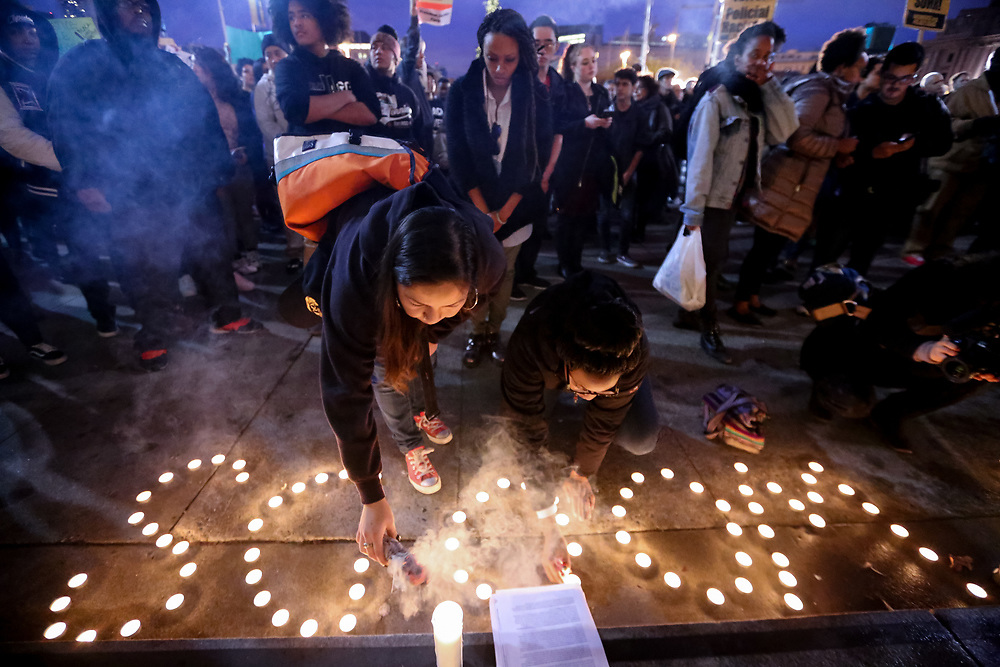 Protestors gather at the steps of San Francisco City Hall during a vigil for Mario Woods, who was fatally shot by police officers a week earlier, in San Francisco, Calif., Wednesday, December 9, 2015.<br /> <br /> Woods, a 26-year-old San Francisco resident, died after being shot by five police officers with 21 bullets striking his body in the city's Bayview District on December 2, 2015. The officers involved in the fatal shooting were not faced with criminal charges after a decision was reached by the San Francisco District Attorney's Office in 2018.