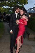 LAURENT BENBAMOU; AMY MOLYNEAUX; , Serpentine Summer party 2012 sponsored by Leon Max. Pavilion designed by Herzog & de Meuron and Ai Weiwei. Kensington Gardens. London. 26 June 2012.