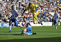 Photo: Tony Oudot/Richard Lane Photography.Colchester United v Leeds United. Coca Cola League One. 29/08/2009. <br /> Jermaine Beckford of Leeds goes close on goal but is tackled by Pat Baldwin of Colchester