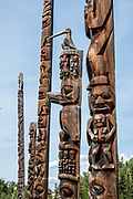 "Gitanyow Totem Poles, on the Kitwanga River in British Columbia, Canada. Listed as a National Historic Site of Canada, Gitanyow (formerly Kitwancool) village is a First Nations reserve community of about 400 Gitxsan people. Posted 1967 BC sign: ""These stately monuments in cedar proclaim the owner's clan status and inherited family traditions, but were never associated with religion. Clan crests portrayed mythical creatures, sometimes in human form, from the legendary history of the clan."" The word totem derives from the Algonquian word odoodem meaning ""(his) kinship group"". Gitanyow is on a short side loop off the scenic Stewart–Cassiar Highway (Highway 37, aka Dease Lake Highway), just 24 km north of the junction with Yellowhead Highway (Hwy 16)."