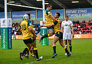 Australia full-back Jack Maddocks is congratulated by team mates after scoring in the opening minute  during the World Rugby U20 Championship  match England U20 -V- Australia U20 at The AJ Bell Stadium, Salford, Greater Manchester, England on June  15  2016, (Steve Flynn/Image of Sport)