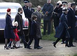 EXCLUSIVE ALL ROUNDER The royal family attend St Mary Magdalene Church on the Sandringham estate. Meghan Markle joined Prince Harry the Duke of Cambridge and Duchess of Cambridge for their walk to the church. Meghan could not resist joking and waving at a member of the crowd<br /> <br /> 25 December 2017.<br /> <br /> Please byline: Vantagenews.com