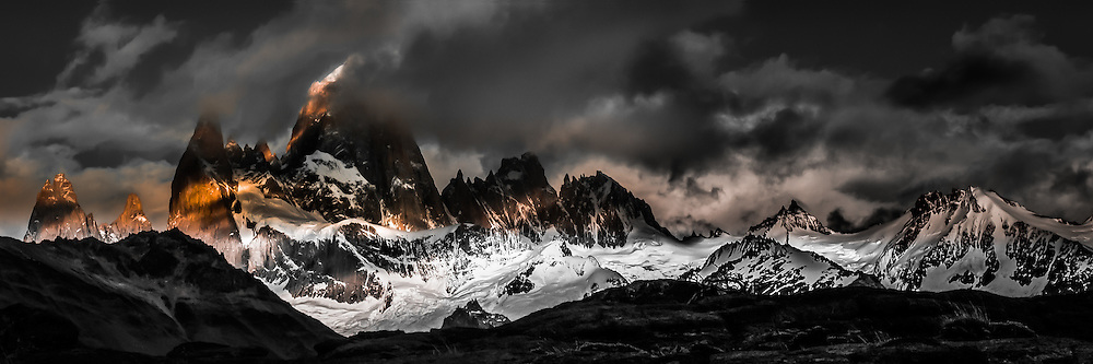 This is the Fitz Roy Massif in Argentina. The photo was taken in January (early summer) from a cold and very windy hilltop outside of El Chalten