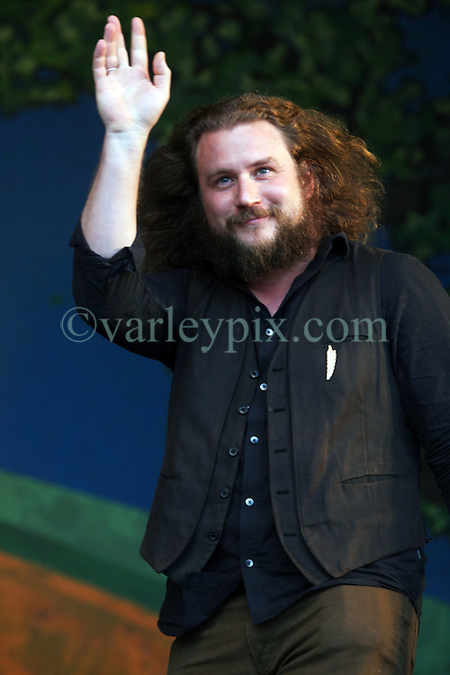 05 May 2012. New Orleans, Louisiana,  USA. .New Orleans Jazz and Heritage Festival. .Jim James performs with the 'Preservation Hall and Friends' ensemble. .Photo; Charlie Varley.