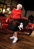 Ann Crowell prepares for Happy Daze, a Trinity-on-Main fundraiser in New Britain, Conn.