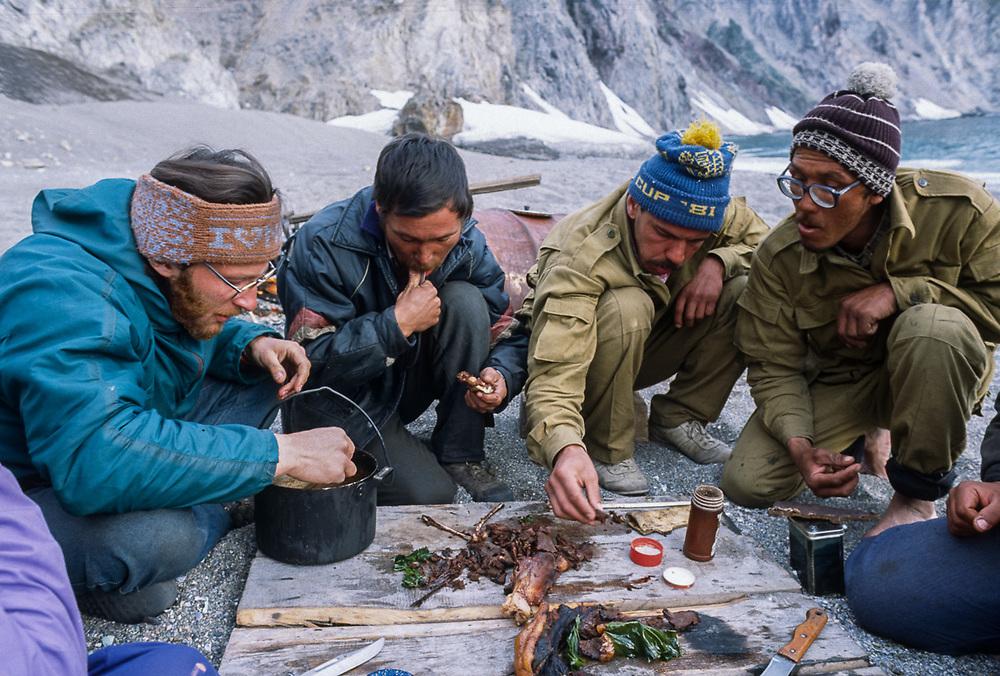 Afanassi Makovnev eats boiled seal with Yupik hunters, Gulf of Anadyr near the Village of Sireniki, Chukotsk Peninsula, Northeast Russia