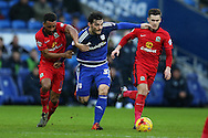 Tony Watt of Cardiff city © breaks between Blackburn's Lee Williamson (l) and Tom Lawrence ®.  Skybet football league championship match, Cardiff city v Blackburn Rovers at the Cardiff city stadium in Cardiff, South Wales on Saturday 2nd Jan 2016.<br /> pic by Andrew Orchard, Andrew Orchard sports photography.