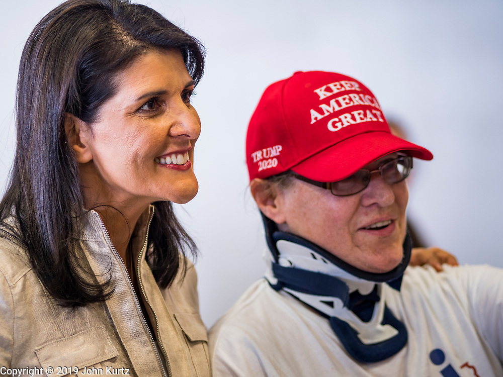 """15 JUNE 2019 - BOONE, IOWA: Former UN Ambassador NIKKI HALEY poses for pictures at """"Joni's Roast and Ride,"""" an annual fund raiser held by US Senator Joni Ernst (R-IA). Ernst, Iowa's junior US Senator, kicked off her re-election campaign during the """"Roast and Ride"""", an annual fund raiser and campaign event has she held since originally being elected to the US Senate in 2014.      PHOTO BY JACK KURTZ"""