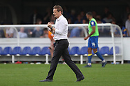 AFC Wimbledon manager Neal Ardley walking off the pitch and playing with his watch during the EFL Sky Bet League 1 match between AFC Wimbledon and Oldham Athletic at the Cherry Red Records Stadium, Kingston, England on 21 April 2018. Picture by Matthew Redman.
