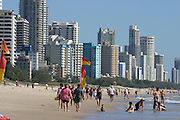"""Whether the name refers to the fine sand on its beaches or the money pouring in from commercialization, Brisbane's famed Gold Coast has become Australia's biggest tourist development. Every summer, throngs of just-graduated high school students invade Surfers Paradise, as this beach 30 miles southeast of the city is known. Their arrival kicks off what is sardonically called """"schoolies week."""" (Supporting image from the project Hungry Planet: What the World Eats.)"""