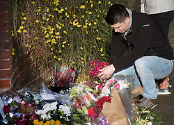 © Licensed to London News Pictures. 26/12/2016. Goring-, UK. Fans of George Michael place floral tributes outside his riverside house . Pop superstar George Michael died on Christmas day at his Oxfordshire home on the River Thames aged 53. Photo credit: Peter Macdiarmid/LNP