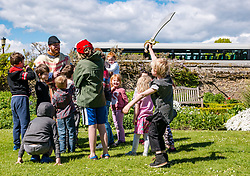 Dirleton Castle, East Lothian, Scotland, United Kingdom, 11 May 2019. Medieval Day:  Historic Environment Scotland family fun day at the Living Medieval Village in the castle gardens.  Children learn to march in an army. Finn, aged 6 years, gets into the fighting spirit. Credit: Sally Anderson/Alamy Live News/Alamy Live News