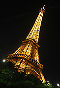 Low angle view of the Eiffel Tower in Paris illuminated at night
