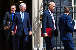 London, July 18th 2017. In a clear demonstration of unity with a cabinet that has seemed to be split over Brexit and other issues,  Government ministers, L-R International Trade Secretary Liam Fox, Defence Secretary Michael Fallon, Transport Secretary Chris Grayling and Chief Whip (Parliamentary Secretary to the Treasury) Gavin Williamson leave the last cabinet meeting together before the Parliamentary summer recess at Downing Street in London.