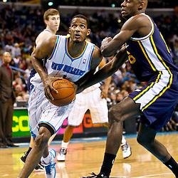 December 17, 2010; New Orleans, LA, USA; New Orleans Hornets small forward Trevor Ariza (1) drives past Utah Jazz center Francisco Elson (16) during the second half at the New Orleans Arena.  The Hornets defeated the Jazz 100-71. Mandatory Credit: Derick E. Hingle